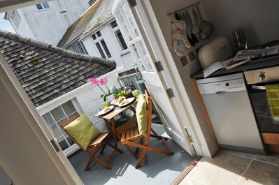 Kitchen opens on to sunny terrace