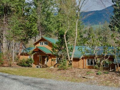 Photo for Romantic and stylish riverfront retreat with hot tub!