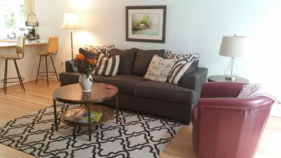 Open concept, spacious main living area with gas fireplace,TV, and new furniture