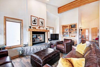 Living room boasts gas fireplace, flat screen tv with cable and DVD player