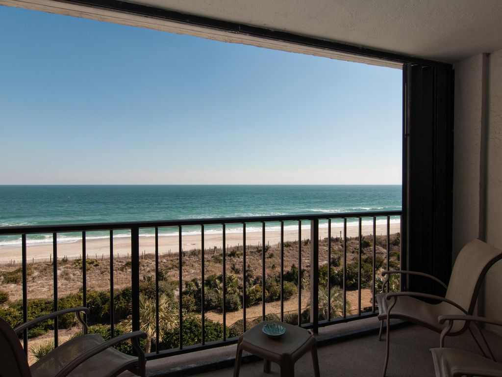 oceanfront balcony accessible from living room and master bedroom