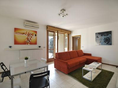 Photo for Bright flat with 110 sq. mt terrace and free parking!