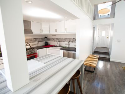 Photo for Newly remodeled modern home 1300 ft. from sand in heart of the Hip District.
