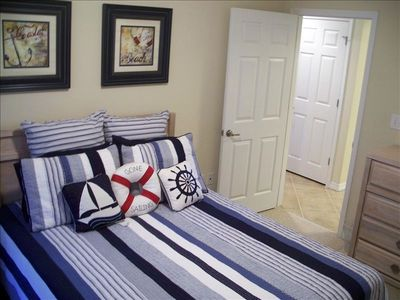 Lovely Nautical Guest Room Features a Queen Bed