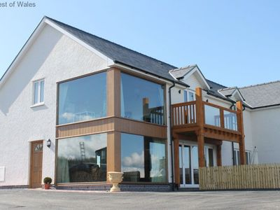 Photo for This light, airy house with views of the green fields and mountains of West Wales provides generous