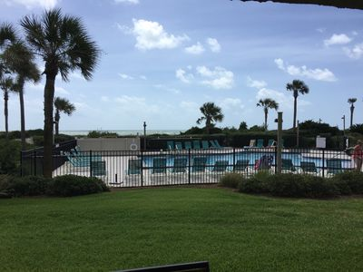 Pool just to right of patio. Walkway to beach is right beside pool-so convenient