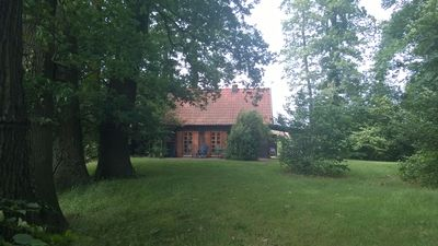 Photo for Oasis of peace and tranquility in our house on a high wooded lot