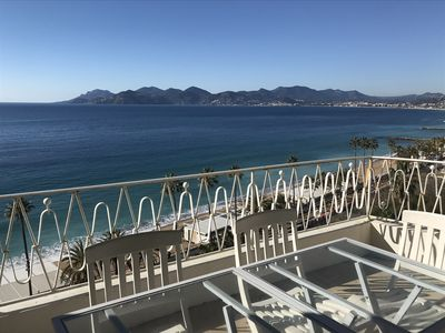 Photo for Beachfront, panoramic view of bay of Cannes, terrace top floor