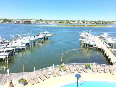 Photo for Boat Slip with Lift, Paddle board, and Large Private Deck!