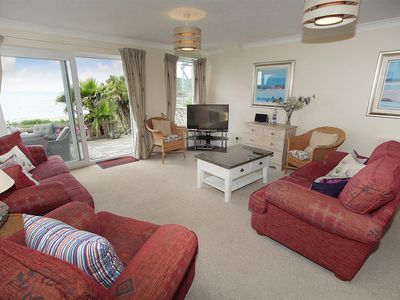 Photo for This beautiful seaside apartment is in a great location with fabulous views over the bay. Interiors
