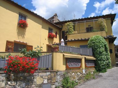 Photo for Cosy apartment in villa with WIFI, pool, TV, panoramic view and parking, close to Greve In Chianti