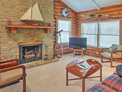 The cozy living room features a flat screen TV for your entertainment.