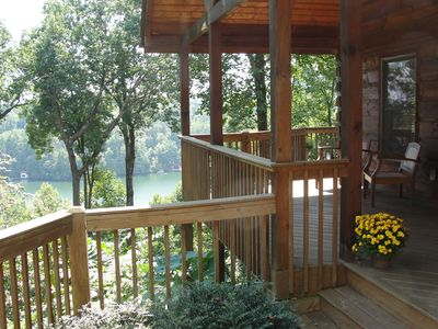 Spectacular lake and mountain views from front porch and wraparound deck.
