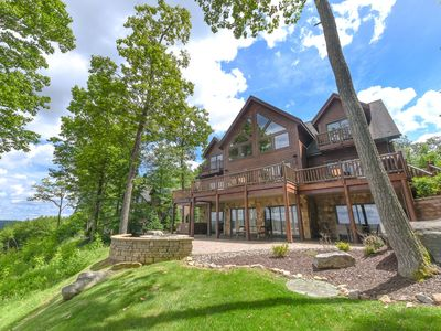 Photo for Lakefront log chalet, hot tub, fireplaces, large deck, beautiful rustic interior!