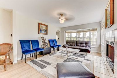 There's Room for Everyone - The spacious living room is beautifully decorated with enough seating for the whole family to find their favorite seat.