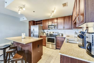 Open Kitchen with stainless-steel appliances!