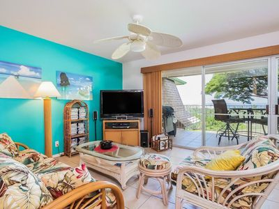 Photo for Colorful condo, private lanai, BBQ, WiFi, Full Kitchen- Beach equipment provided