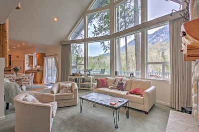 Floor-to-ceiling windows brighten this living room and offer riverfront views!