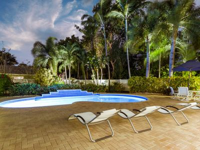 Photo for Private Tropical Oasis, Pool! Walk to shopping & entertainment. Great Location.
