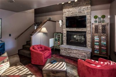 Living in Comfort - Experience the crystal-clear flat screen in the living room at Fifth Dimension. There are comfortable, clean sofas with enough space for everyone to relax after a long day exploring Ruidoso.