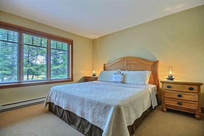 Upper floor master bedroom with Kind size bed and flat screen tv.