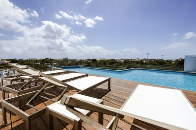roof top pool with a beautiful view and partial view of the ocean...