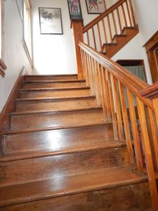 Newly refinished steps that lead to the upstairs.