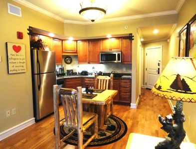 Beautiful Kitchen featuring granite counter tops and all stainless appliances.