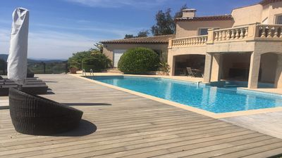 Photo for Luxury apartment with shared garden and pool, stunning mountain and sea views