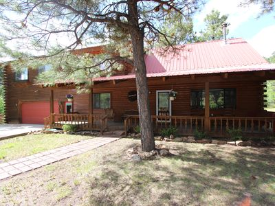 Photo for Golf Course Log Home with full guest apartment, hot tub, centrally located!