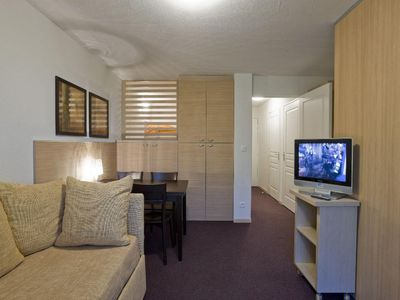 Photo for Surface area : about 30-32 m². Living room with bed-settee. Sleeping area with 2 single beds
