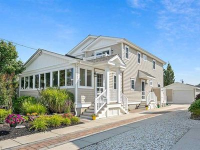 Photo for Master suite with a walk-in closet and its own Juliette deck. Quiet street and a relatively short walk to the beach enhance this well cared for retreat. Spacious Sunroom!