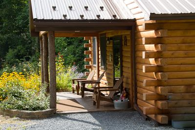 Cabin B covered porch and Adirondack chairs