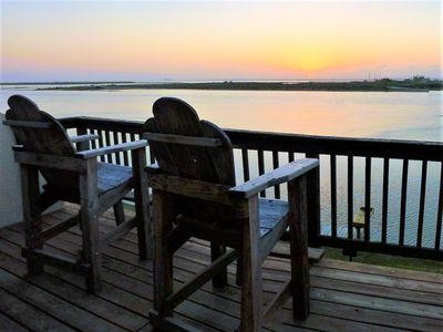 Photo for Bayfront Condo on Padre Island. Incredible Sunset View. Dock on the Bay. Pool.