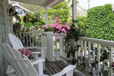 Front porch - enjoy your morning coffee surrounded by gorgeous flowers and singing birds!