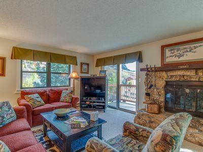 Photo for Mountain view condo w/ balcony, fireplace & shared hot tub - walk to lifts!