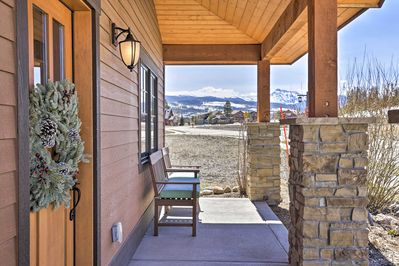 Enjoy stunning Rocky Mountain views from a private hot tub and furnished porch.