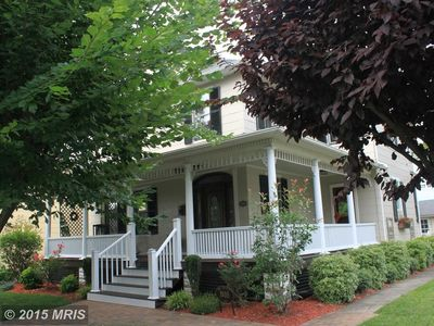 We're located on a corner street with a shaded front porch  with ample space