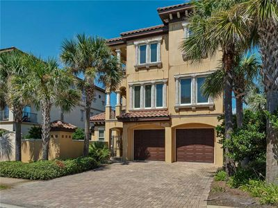 Spacious & Updated Home with Elevator! Includes Private Pool & Free Beach Service!