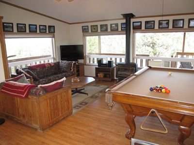 High Desert Haven Living Area. Pool table, gas stove, and large picture windows.