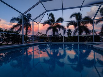 Photo for Tropical waterfront villa with heated pool, lanai, boat lift, and tiki hut.