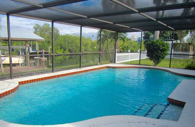 Photo for Tropical Waterfront/ Heated Pool/Boat Dock and lift,fishing,firepit,Pet Friendly