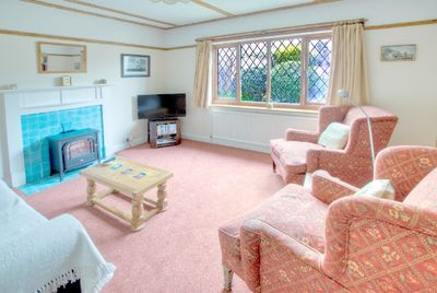 Sitting room with views over the cottage style garden.