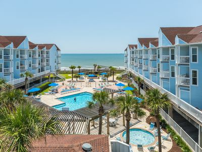 Photo for Waterfront luxury w/ a shared pool, hot tub, BBQ area, & private beach access