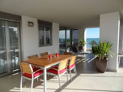 Photo for Spectacular views. WIFI. Very clean, bright, cheerful, elegant and new. Facing the sea. Condo with pool.