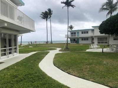 Photo for MONTHLY TERM UPDATED BEACHFRONT CONDO WALK OUT YOUR DOOR RIGHT TO THE BEACH