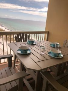 Oversized balcony with full sized counter height dining tables plus 2 loungers