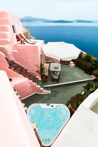 Photo for SantoriniParadise: PINK cave house, Caldera and volcano view, hot tub!