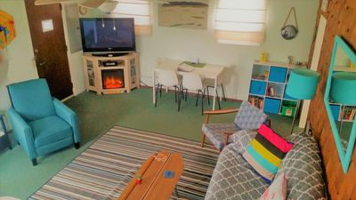 Living room w/electric Fireplace, TV/DVD w/Netflix, Amazon video, games & toys!