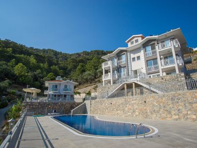 Photo for Apartment in natural environment with big pool and seaview